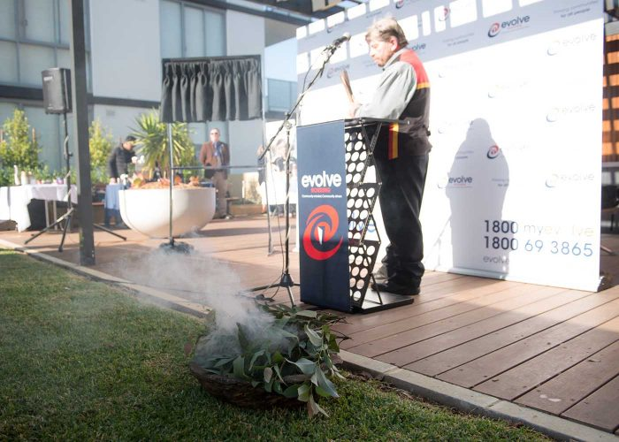 Uncle Lex opens event with a traditional Welcome to Country smoke ceremony.