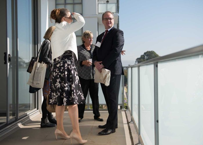 CEO Andrea Galloway takes guests on tour of a Harts Landing apartment.