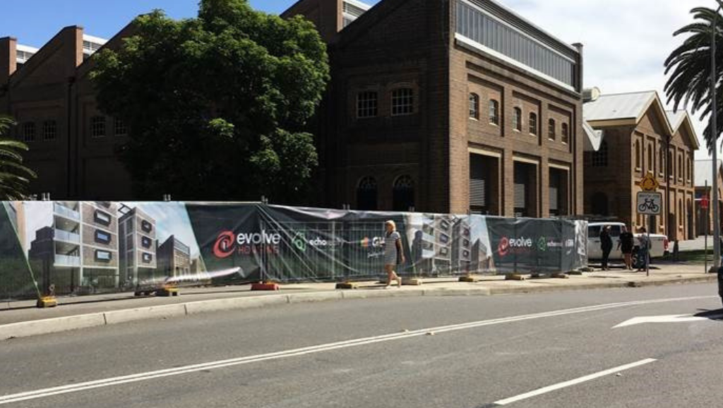 An image showing fencing up around the site at 4 Merewether Street, Newcastle that will be developed into new affordable housing