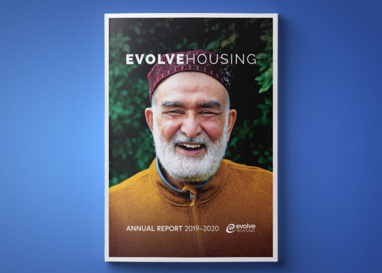 front cover of 2020 annual report. man smiling with words evolve housing annural report 2019-2020 written on page